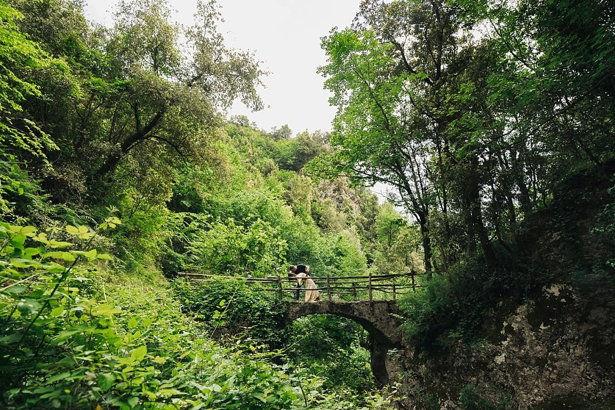 Jordan & Cass kissing on an old bridge during their Amalfi Coast Engagement