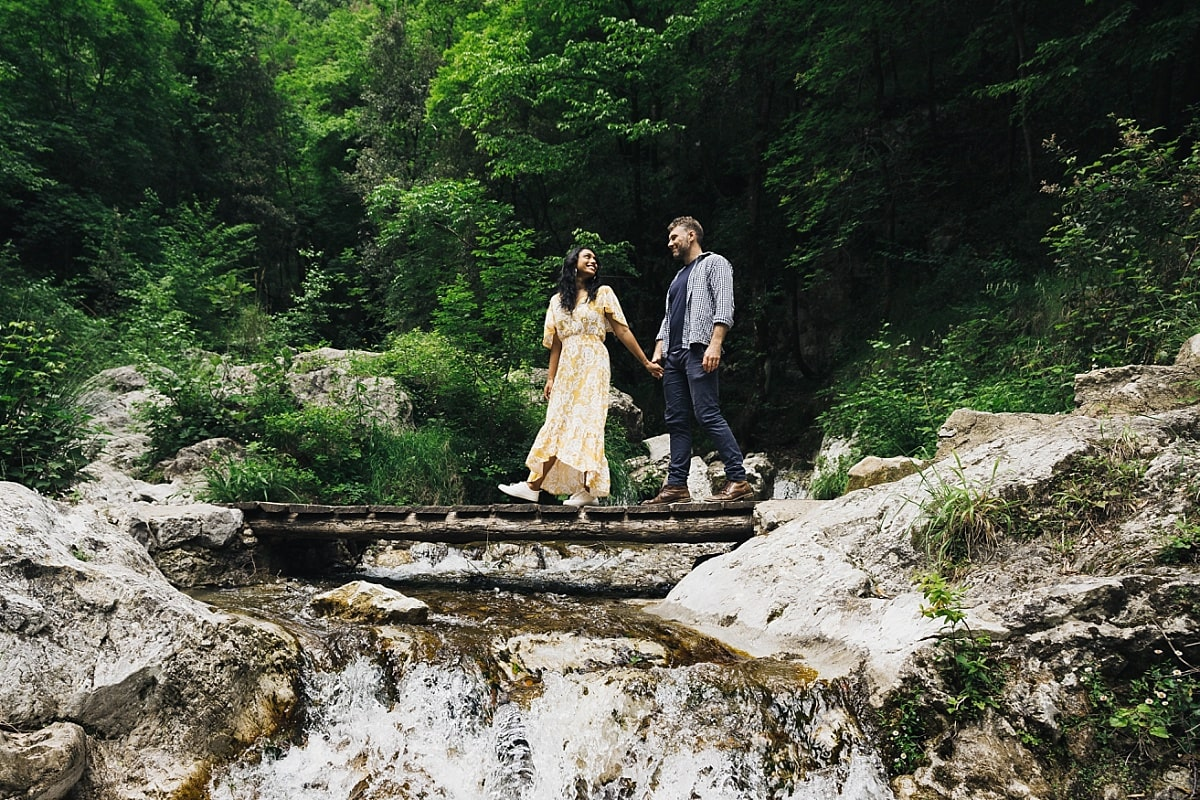 Jordan & Cass crossing a wooden waterfall over a bridge during their Amalfi Coast Engagement