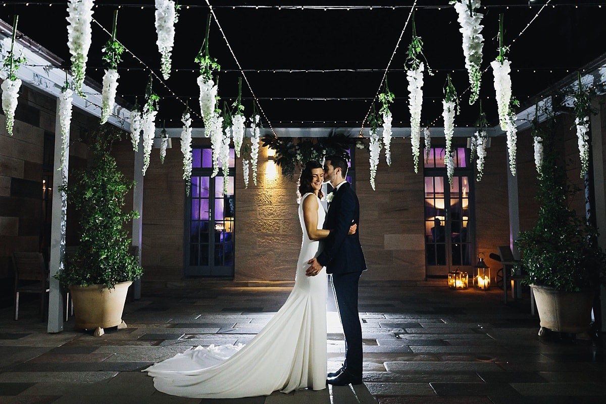 Bride and Groom Night Photo in the sandstone courtyard at Gunners Barracks