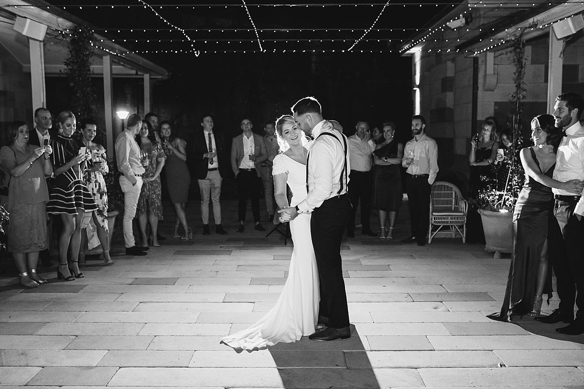 Bride and Groom during their first dance at Gunners Barracks in the sandstone courtyard
