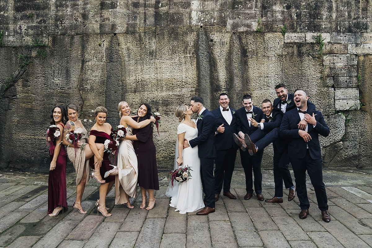 Bridal party in the sandstone courtyard at Gunners Barracks