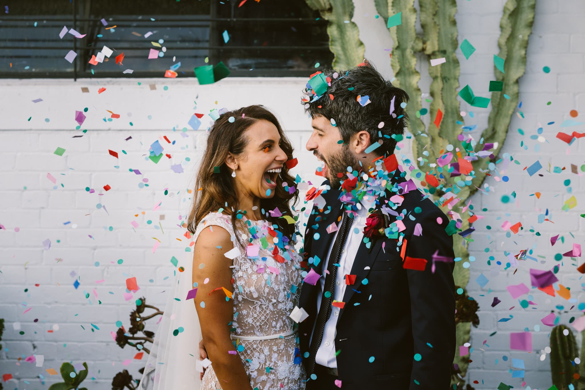 Bride and Groom with Confetti at Gather and Tailor which is a beautiful Melbourne Wedding Venue