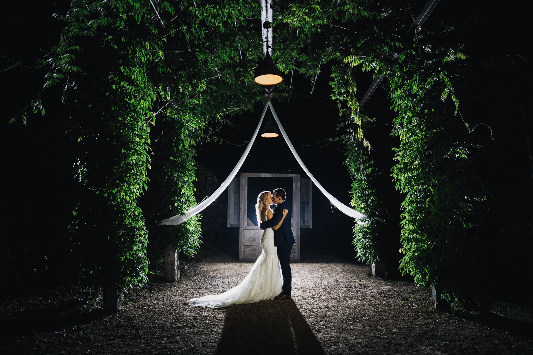 Bride and Groom at night under the arbour at Fernbank Farm which is one of the best Central Coast Wedding Venues