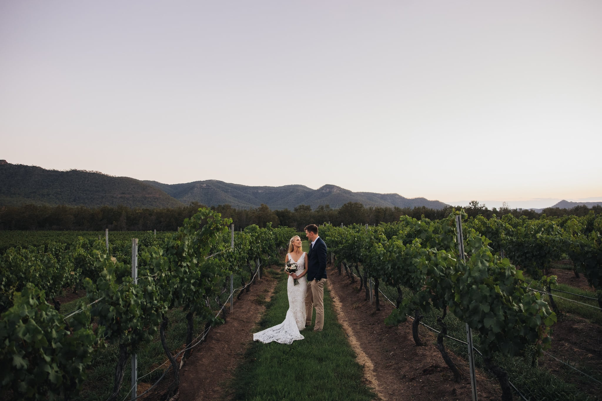 Bride and Groom at Margan Estate in the Hunter Valley at Sunset amongst the Vines