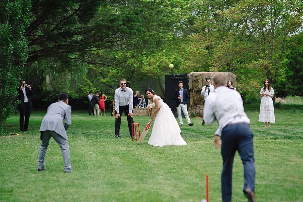 Wedding guests playing cricket at Montrose Berry Farm