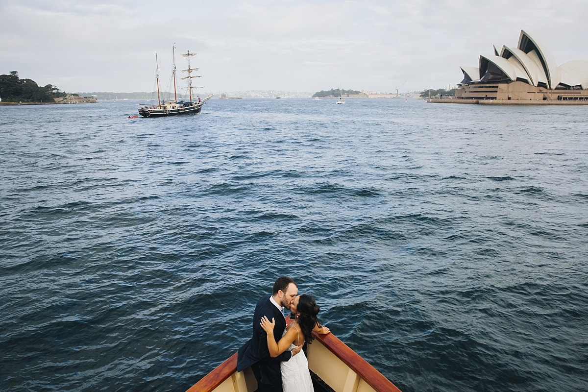 Bride and Groom on Ferry on Sydney Harbour overlooking Sydney Opera House